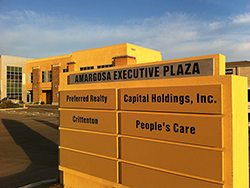 Monument sign in front of Amargosa Executive Plaza